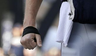 Tape covers part of New England Patriots quarterback Tom Brady's right hand before the AFC championship NFL football game against the Jacksonville Jaguars, Sunday, Jan. 21, 2018, in Foxborough, Mass. (AP Photo/David J. Phillip)