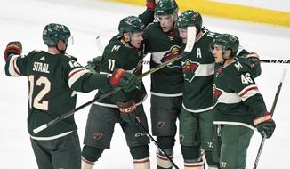 Minnesota Wild, from left, Eric Staal, Zach Parise, Charlie Coyle, Ryan Suter and Jared Spurgeon celebrate Spurgeon's goal in the first period of an NHL hockey game Saturday, Jan. 20, 2018, in St. Paul, Minn. (AP Photo/Tom Olmscheid)
