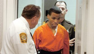 In this Oct. 26, 2004, file photo, Lee Boyd Malvo enters a courtroom in the Spotsylvania, Va., Circuit Court. A federal appeals court is set to hear arguments Tuesday, Jan. 22, 2018, in a case focusing on the life sentences given to D.C. sniper Malvo. A federal judge in Virginia found that Malvo is entitled to new sentencing hearings in light of a U.S. Supreme Court ruling that mandatory life sentences for juveniles are unconstitutional. Malvo was 17 when he was arrested in a series of random shootings that killed 10 people and wounded three in Virginia, Maryland and the District of Columbia in 2002. (Mike Morones/The Free Lance-Star via AP)