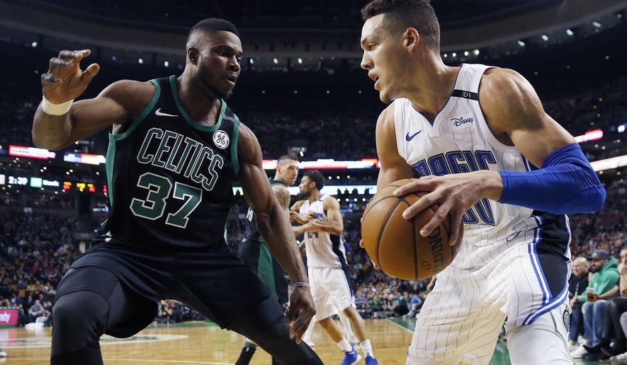 Orlando Magic's Aaron Gordon (00) looks to move against Boston Celtics' Semi Ojeleye (37) during the third quarter of an NBA basketball game in Boston, Sunday, Jan. 21, 2018. The Magic won 103-95. (AP Photo/Michael Dwyer)