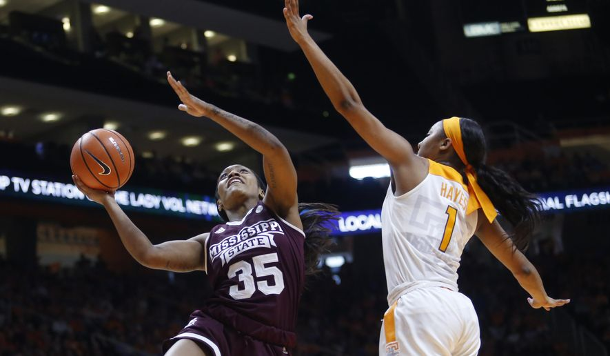 Mississippi State guard Victoria Vivians (35) is defended under the basket by Tennessee guard Anastasia Hayes (1) in the first half of an NCAA college basketball game Sunday, Jan. 21, 2018, in Knoxville, Tenn. (AP Photo/Crystal LoGiudice)