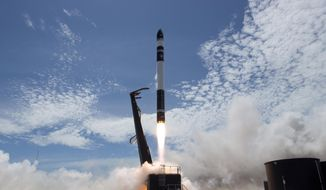 In this photo provided by Rocket Lab, Electron rocket carrying only a small payload of about 150 kilograms (331 pounds), lifts off from the Mahia Peninsula on New Zealand's North Island's east coast. The rocket launched from New Zealand on Sunday successfully reached orbit carrying small commercial satellites. (Rocket Lab via AP)