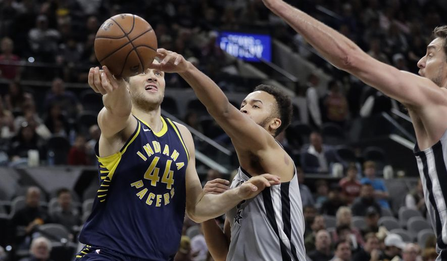 Indiana Pacers forward Bojan Bogdanovic (44) tries to shoot past San Antonio Spurs forward Kyle Anderson, center, and center Pau Gasol, right, during the first half of an NBA basketball game, Sunday, Jan. 21, 2018, in San Antonio. (AP Photo/Eric Gay)