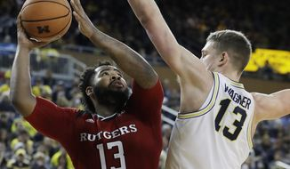Rutgers forward Matt Bullock (13) shoots over Michigan forward Moritz Wagner (13) during the first half of an NCAA college basketball game, Sunday, Jan. 21, 2018, in Ann Arbor, Mich. (AP Photo/Carlos Osorio)