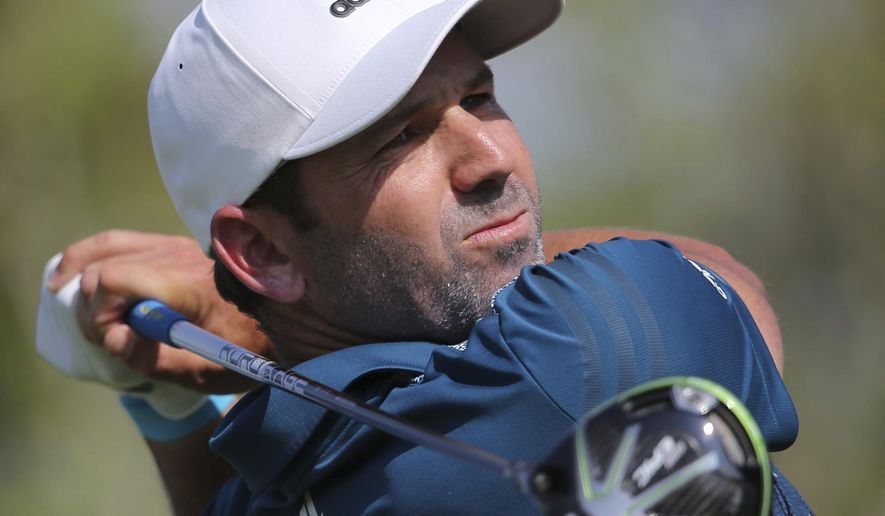 FILE - In this Nov. 18, 2017, file photo, Sergio Garcia from Spain tees off on the 2nd fairway during the third round of the DP World Tour Championship golf tournament in Dubai, United Arab Emirates. Masters champion Garcia made four early birdies to take the third-round lead at the Singapore Open on Sunday, Jan. 21, 2018, as organizers rushed to finish the tournament on time after three days of weather delays. (AP Photo/Kamran Jebreili, File)