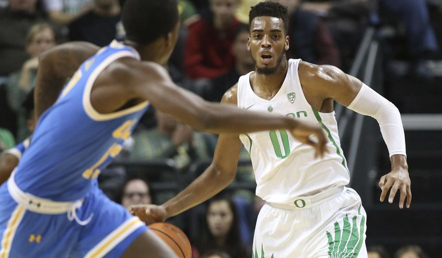 UCLA's Prince Ali, left, runs down court ahead of Oregon's Troy Brown Jr. during the first half of an NCAA college basketball game Saturday, Jan. 20, 2018, in Eugene, Ore. (AP Photo/Chris Pietsch) ** FILE **