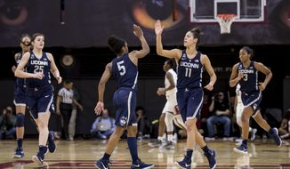 Connecticut's Kia Nurse, center right, celebrates his shot with Crystal Dangerfield, center left, during the first half of an NCAA basketball game against Temple, Sunday, Jan. 21, 2018, in Philadelphia. (AP Photo/Chris Szagola)