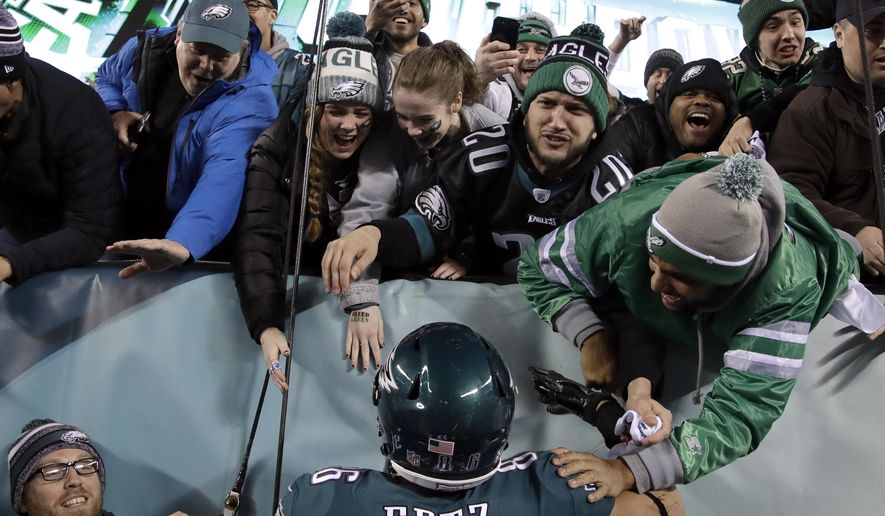 Philadelphia Eagles' Zach Ertz celebrates a touchdown with fans during the second half of the NFL football NFC championship game against the Minnesota Vikings Sunday, Jan. 21, 2018, in Philadelphia. (AP Photo/Matt Rourke)