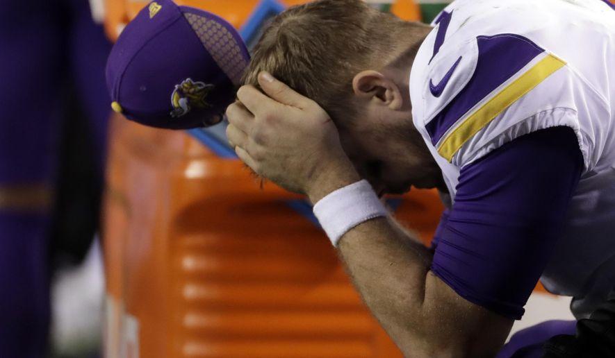 Minnesota Vikings' Case Keenum reacts on the bench during the second half of the NFL football NFC championship game against the Philadelphia Eagles Sunday, Jan. 21, 2018, in Philadelphia. (AP Photo/Matt Slocum)