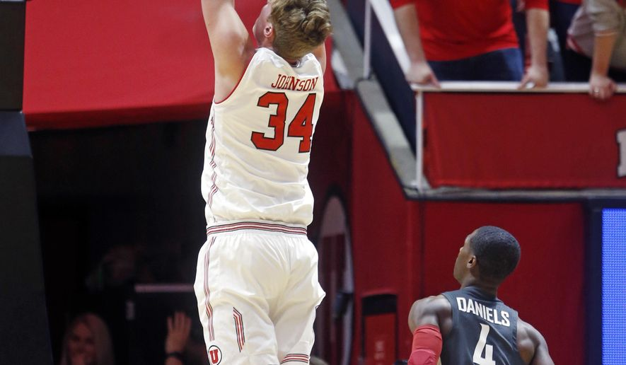 Utah forward Jayce Johnson (34) dunks as Washington State guard Viont'e Daniels (4) looks on in the first half during an NCAA college basketball game Sunday, Jan. 21, 2018, in Salt Lake City. (AP Photo/Rick Bowmer)