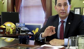 In this Friday, Jan . 19, 2017, photo, Wisconsin Gov. Scott Walker discusses health care-related proposals he will ask the Legislature to approve in Madison, Wis. (AP Photo/Scott Bauer)