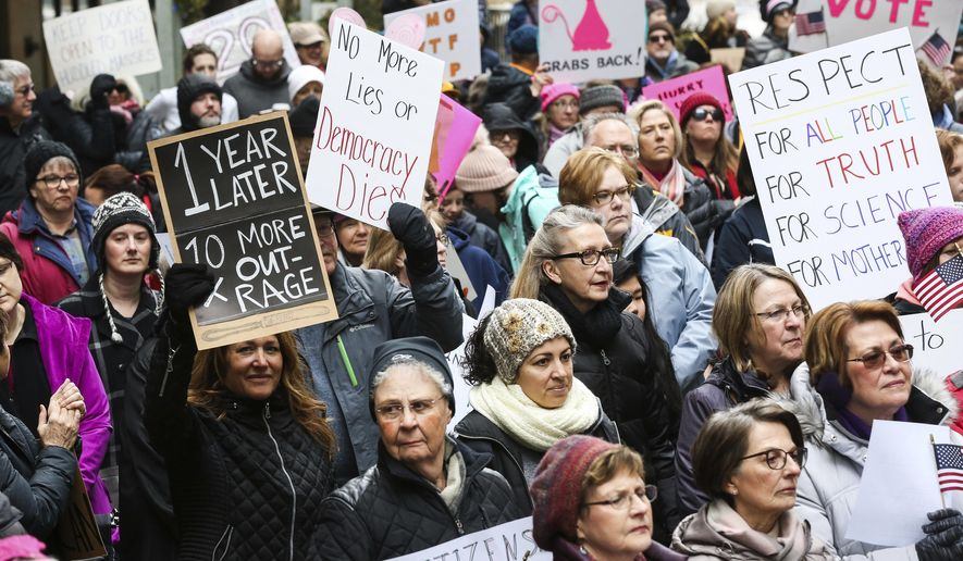 Demonstrators participate in the Women's March rally at Peace Plaza in downtown Rochester, Minn., on Saturday, Jan. 20, 2018. (Andrew Link/The Rochester Post-Bulletin via AP)