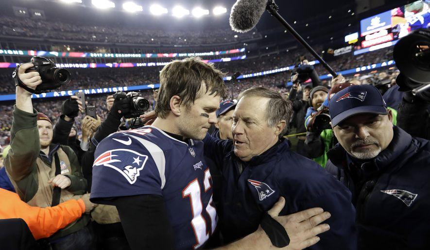 New England Patriots quarterback Tom Brady, left, hugs coach Bill Belichick after the AFC championship NFL football game against the Jacksonville Jaguars, Sunday, Jan. 21, 2018, in Foxborough, Mass. The Patriots won 24-20. (AP Photo/David J. Phillip)