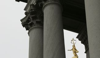 "The bronze statue ""Commonwealth"" stands atop of the Pennsylvania Capitol building, Thursday, Sept. 14, 2006, in Harrisburg, Pa. The state Supreme Court on Thursday, Sept, 14, 2006, reinstated pay raises for 1,200 elected judges and district judges in a decision that added new fuel to an issue that has roiled Pennsylvania politics for more than a year. The justices ordered judges' pay, including their own, to return to the level it was at in November, before a four-month-old pay-raise law was repealed in the wake of widespread public anger. (AP Photo/Carolyn Kaster)"