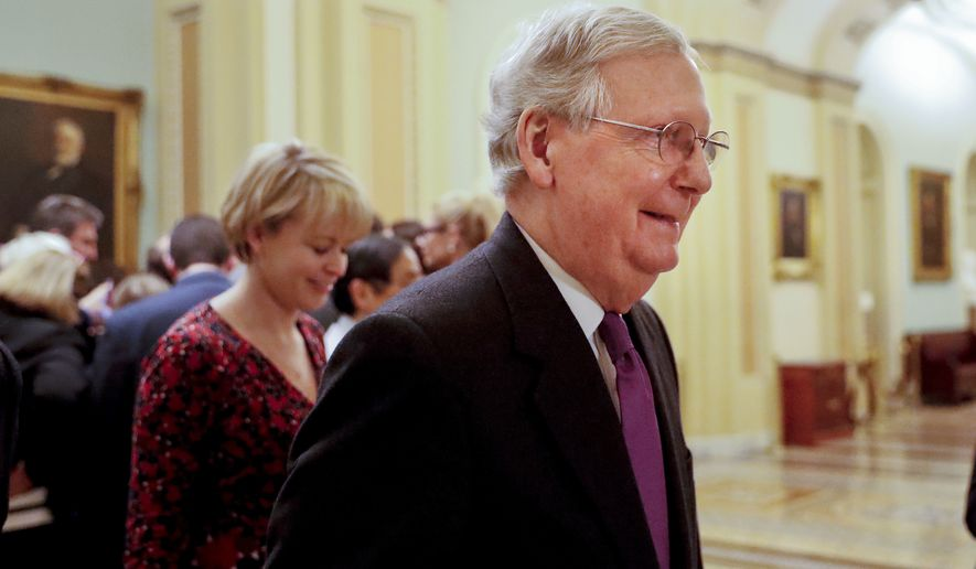 Senate Majority Leader Mitch McConnell of Ky., walks back to his office on Capitol Hill in Washington, Monday, Jan. 22, 2018. (AP Photo/Pablo Martinez Monsivais)