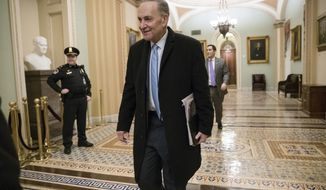 Senate Minority Leader Chuck Schumer, D-N.Y., arrives at the Capitol at the start of the third day of the government shutdown, in Washington, Monday, Jan. 22, 2018. (AP Photo/J. Scott Applewhite)
