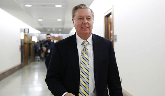 Sen. Lindsey Graham, R-S.C., leaves after meeting with a bipartisan group of senators, Monday Jan. 22, 2018, on Day. (AP Photo/Jacquelyn Martin)