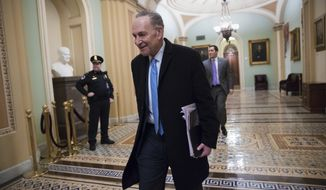 Senate Minority Leader Chuck Schumer, D-N.Y., arrives at the Capitol at the start of the third day of the government shutdown, in Washington, Monday, Jan. 22, 2018. Schumer, arguably the most powerful Democrat in Washington, is trying to keep his party together to force a spending bill that would include protections for young immigrants. (AP Photo/J. Scott Applewhite)