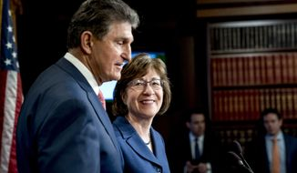 Sen. Susan Collins, R-Maine, right, and Sen. Joe Manchin, D-W.Va., left, arrive to speak at a news conference on Capitol Hill in Washington, Monday, Jan. 22, 2018, after Senators reach an agreement to advance a bill ending government shutdown. (AP Photo/Andrew Harnik)