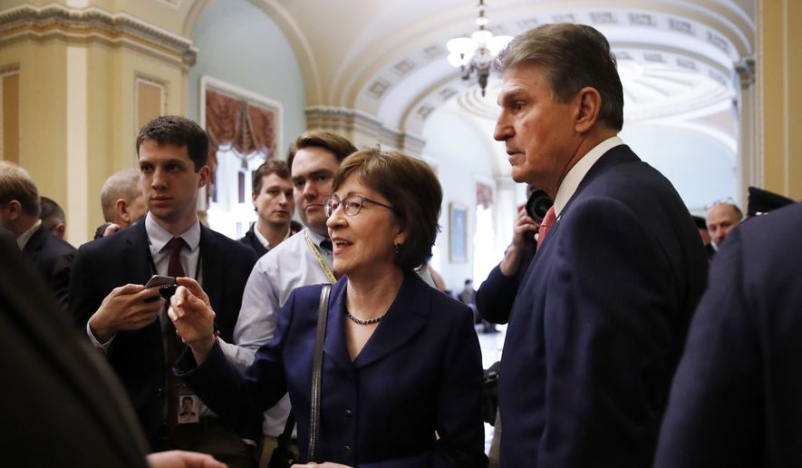 Sen. Susan Collins, R-Maine, left, and Sen. Joe Manchin, D-W.Va., speak to members of the media after leaving the Senate chamber which voted yes on a procedural vote to reopen the government, Monday Jan. 22, 2018,, on Capitol Hill in Washington. (AP Photo/Jacquelyn Martin)