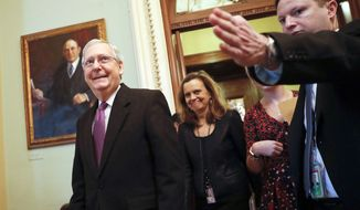 Senate Majority Leader Mitch McConnell of Ky., leaves the Senate chamber on Capitol Hill in Washington, Monday, Jan. 22, 2018. Senate leaders have reached an agreement to advance a bill ending government shutdown. (AP Photo/Pablo Martinez Monsivais)