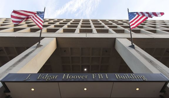 """The FBI was expected to provide Congress with a new batch of texts that two employees exchanged from Dec. 14, 2016, to May 17, 2017, but the agency told lawmakers that """"misconfiguration issues"""" caused a loss of the texts. (Associated Press/File)"""