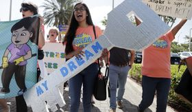 """Maria Angelica Ramirez carries a large key reading """"My Dream"""" during a protest outside the office of Sen. Marco Rubio, Florida Republican, in support of Deferred Action for Childhood Arrivals. (Associated Press)"""