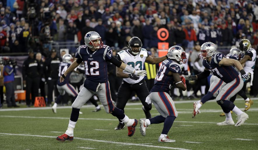 New England Patriots quarterback Tom Brady (12) hands off the ball to running back Dion Lewis (33) during the second half of the AFC championship NFL football game against the Jacksonville Jaguars, Sunday, Jan. 21, 2018, in Foxborough, Mass. (AP Photo/David J. Phillip)