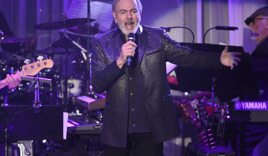 FILE- This Feb. 11, 2017, file photo shows Neil Diamond performing at the Clive Davis and The Recording Academy Pre-Grammy Gala at the Beverly Hilton Hotel in Beverly Hills, Calif. Diamond is retiring from touring after he says he was diagnosed with Parkinsons disease. Diamond turns 77 on Wednesday. Jan. 24, 2018. (Photo by Chris Pizzello/Invision/AP, File)