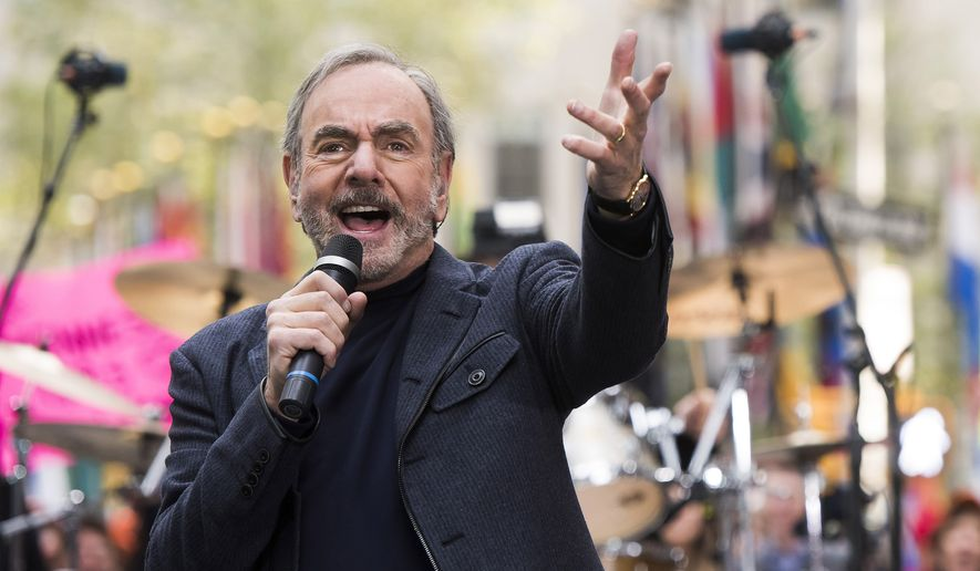 "In this Oct. 20, 2014, file photo, Neil Diamond performs on NBC's ""Today"" show in New York. Diamond is retiring from touring after he says he was diagnosed with Parkinsons disease. Diamond turns 77 on Wednesday. Jan. 24, 2018, and will get the lifetime achievement award at Sundays Grammy awards. (Photo by Charles Sykes/Invision/AP, File)"