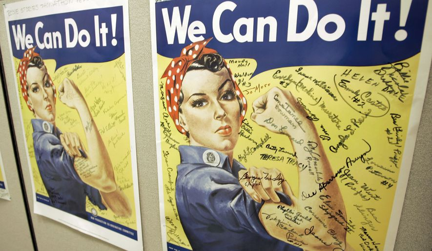 File - In this Oct. 31, 2007 file photo, a poster showing signatures of former Rosie the Riveter's is seen at the offices of the Rosie the Riveter/World War II Home Front National Historic Park in Richmond, Calif. A woman identified by a scholar as the inspiration for Rosie the Riveter, the iconic female World War II factory worker, has died in Washington state. The New York Times reports that Naomi Parker Fraley died Saturday, Jan. 20, 2018, in Longview. She was 96. Multiple women have been identified over the years as possible models for Rosie, but a Seton Hall University professor in 2016 focused on Fraley as the true inspiration. (AP Photo/Eric Risberg, File)