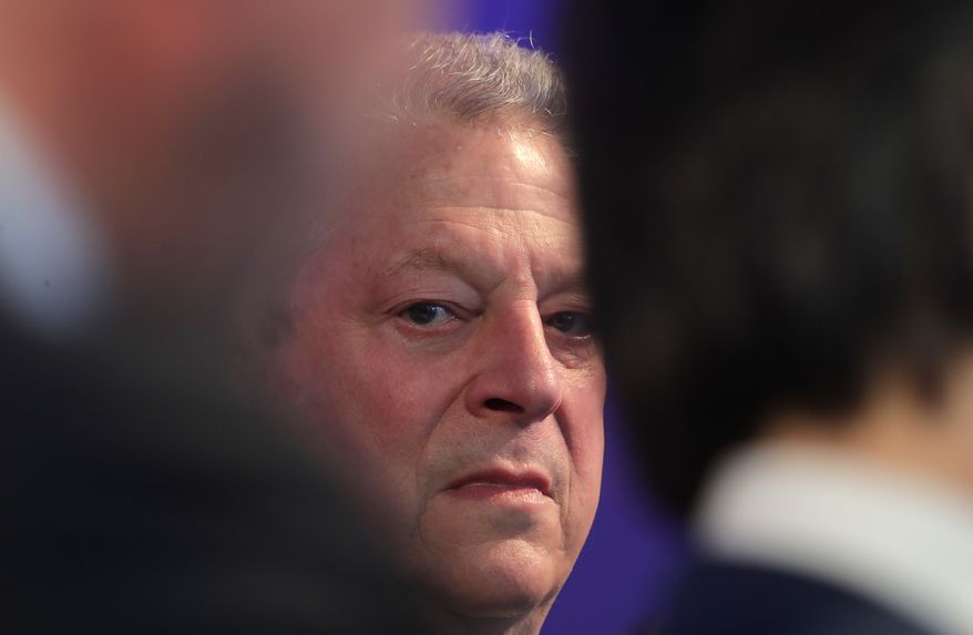 Former U.S. Vice President Al Gore waits for the beginning of the ceremony for the Crystal Awards on the eve of annual meeting of the World Economic Forum in Davos, Switzerland, Monday, Jan. 22, 2018. The award celebrates the achievements of leading artists who are bridge-builders and role models for all leaders of society. (AP Photo/Markus Schreiber)