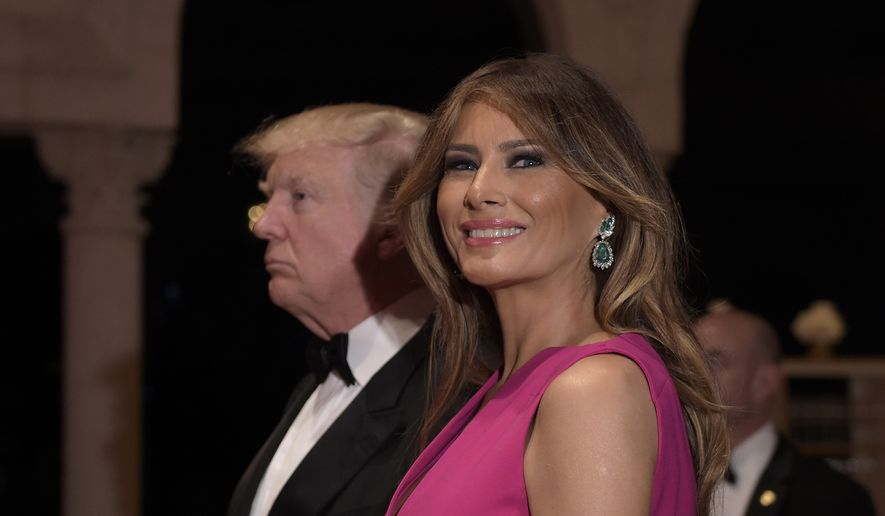 In this Feb. 4, 2017, file photo, President Donald Trump and first lady Melania Trump arrive for the 60th annual Red Cross Gala at Trump's Mar-a-Lago resort in Palm Beach, Fla. (AP Photo/Susan Walsh, File)