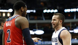 Washington Wizards' John Wall (2) and Dallas Mavericks' J.J. Barea, of Puerto Rico argue after a play in the second half of an NBA basketball game, Monday, Jan. 22, 2018, in Dallas. Barca was charged with a technical foul after the outburst between the two. (AP Photo/Tony Gutierrez)