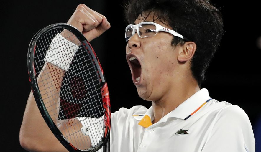 South Korea's Chung Hyeon reacts after winning a point against Serbia's Novak Djokovic during their fourth round match at the Australian Open tennis championships in Melbourne, Australia, Monday, Jan. 22, 2018. (AP Photo/Vincent Thian)
