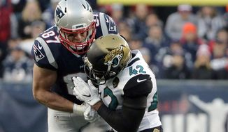 New England Patriots tight end Rob Gronkowski (87) is hit by Jacksonville Jaguars safety Barry Church (42) as he breaks up a pass during the first half of the AFC championship NFL football game, Sunday, Jan. 21, 2018, in Foxborough, Mass. (AP Photo/Steven Senne)