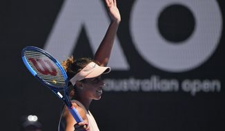 United States' Madison Keys reacts after defeating France's Caroline Garcia in their fourth round match at the Australian Open tennis championships in Melbourne, Australia, Monday, Jan. 22, 2018. (AP Photo/Andy Brownbill)