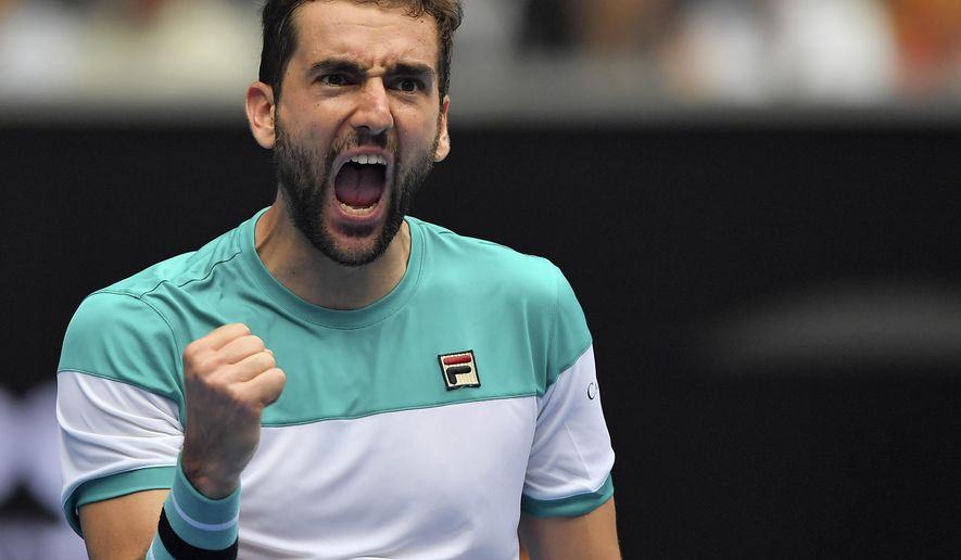 Croatia's Marin Cilic celebrates after defeating Spain's Pablo Carreno Busta in their fourth round match at the Australian Open tennis championships in Melbourne, Australia Sunday, Jan. 21, 2018. (AP Photo/Andy Brownbill)