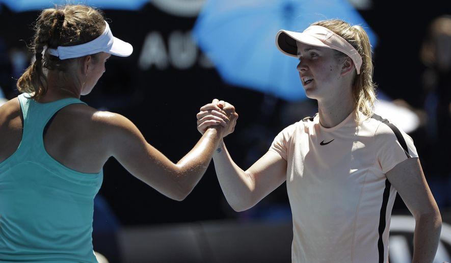 Belgium's Elise Mertens, left, is congratulated by Ukraine's Elina Svitolina after winning their quarterfinal at the Australian Open tennis championships in Melbourne, Australia, Tuesday, Jan. 23, 2018. (AP Photo/Dita Alangkara)