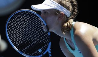 Belgium's Elise Mertens waits to receive serve from Ukraine's Elina Svitolina during their quarterfinal at the Australian Open tennis championships in Melbourne, Australia, Tuesday, Jan. 23, 2018. (AP Photo/Dita Alangkara)