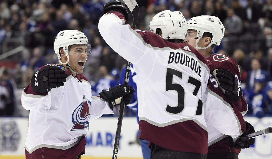 Colorado Avalanche left wing Gabriel Bourque (57) celebrates his goal with center Tyson Jost (17) during first-period NHL hockey game action against the Toronto Maple Leafs in Toronto, Monday, Jan. 22, 2018. (Nathan Denette/The Canadian Press via AP)