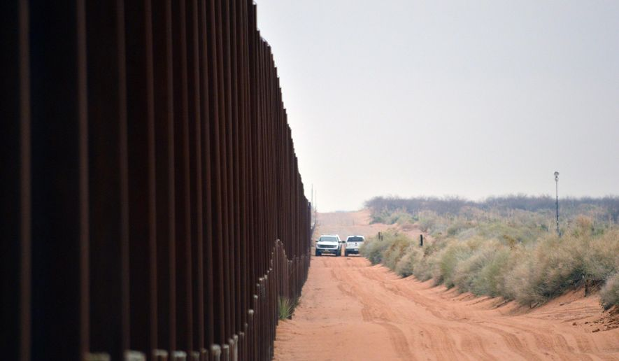 File - In this Jan. 5, 2016 file photo, U.S. Border Patrol vehicles drive next to a U.S-Mexico border fence in the booming New Mexico town of Santa Teresa. The Trump administration is waiving numerous laws to clear the way for replacing existing vehicle barriers along a stretch of the US-Mexico border in New Mexico. The notice published Monday, Jan. 22, 2018, in the Federal Register says the waiver extends around 20 miles west of the Santa Teresa Port of Entry. (AP Photo/Russell Contreras, File)