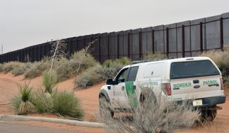 In this Jan. 5, 2016, file photo, a U.S. Border Patrol vehicle drives next to a U.S-Mexico border fence in the booming New Mexico town of Santa Teresa. The Trump administration is waiving numerous laws to clear the way for replacing existing vehicle barriers along a stretch of the US-Mexico border in New Mexico. The notice published Monday, Jan. 22, 2018, in the Federal Register says the waiver extends around 20 miles west of the Santa Teresa Port of Entry. (AP Photo/Russell Contreras, File)