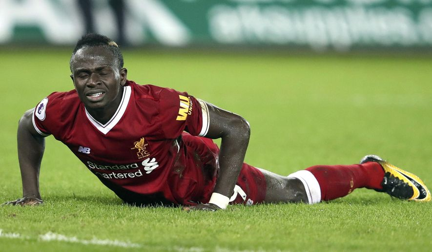 Liverpool's Sadio Mane reacts on the pitch, during the English Premier League soccer match between Swansea City and Liverpool, at the Liberty Stadium, in Swansea, Wales, Monday, Jan. 22, 2018. (Nick Potts/PA via AP)