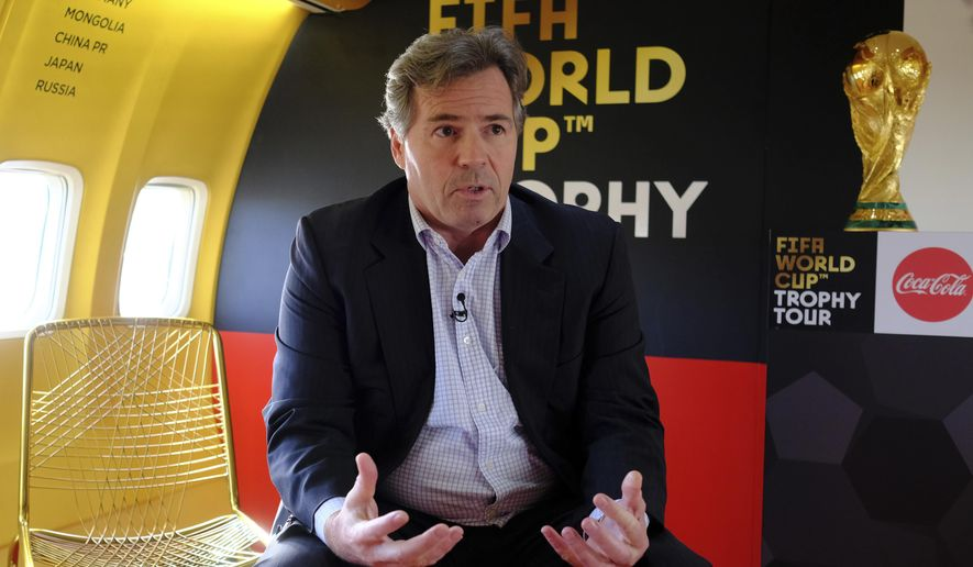 Philippe Le Floc'h the FIFA Chief Commercial Officer talking to the Associated Press on the plane that will take the Wold Cup trophy to 50 counties in the lead up to the World Cup 2018 in Russia, 2018 at Stansted Airport, England, Monday, Jan. 22, 2018 . (AP Photo/Alastair Grant)
