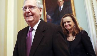 Senate Majority Leader Mitch McConnell of Ky., walks back to his office on Capitol Hill in Washington, Monday, Jan. 22, 2018. Senate leaders have reached an agreement to advance a bill ending government shutdown. (AP Photo/Pablo Martinez Monsivais)