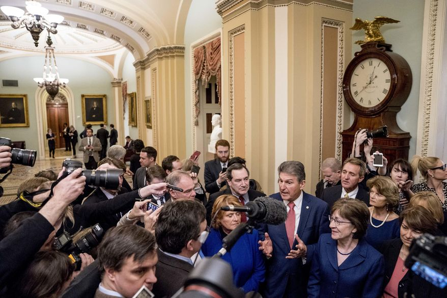 A group of senators gather off the Senate floor to speak to reporters after reaching an agreement to advance a bill ending a government shutdown on Capitol Hill in Washington, Monday, Jan. 22, 2018. From left are, Sen. Tim Kaine, D-Va., Sen. Heidi Heitkamp, D-N.D., Sen. Joe Donnelly, D-Ind., Sen. Joe Manchin, D-W.Va., Sen. Susan Collins, R-Maine, Sen. Jeff Flake, R-Ariz., Sen. Lisa Murkowski, R-Alaska, and Sen. Amy Klobuchar, D-Minn. (AP Photo/Andrew Harnik)
