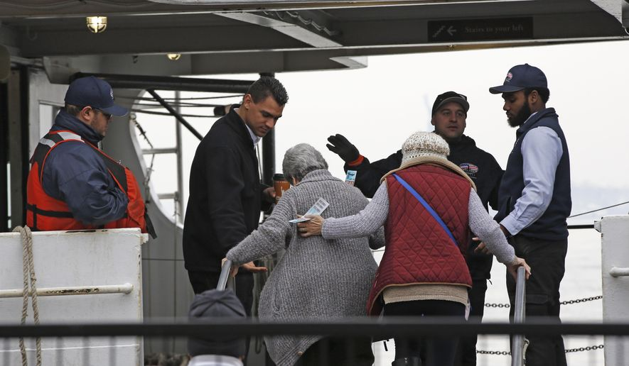 Passengers board a Statue of Liberty and Ellis Island tour boat, Monday, Jan. 22, 2018, in New York, after service resumed during the government shutdown. New York state will be picking up the tab for federal workers at the site New York Gov. Andrew Cuomo said Sunday. (AP Photo/Kathy Willens)