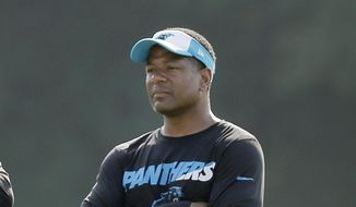 FILE - In this Aug. 3, 2015, file photo, Carolina Panthers assistant head coach Steve Wilks watches players warm up during NFL football team's training camp in Spartanburg, S.C. Wilks is the new head football coach of the Arizona Cardinals. The Cardinals announced Monday, Jan. 22, 2018, that the 48-year-old Carolina Panthers defensive coordinator had agreed to a four-year contract with a team option for a fifth. (AP Photo/Chuck Burton, File) **FILE**