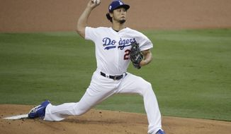 FILE - In this Nov. 1, 2017, file photo, Los Angeles Dodgers starting pitcher Yu Darvish, of Japan, throws against the Houston Astros during the first inning of Game 7 of baseball's World Series in Los Angeles. A person with direct knowledge of the discussions says the Chicago Cubs are having active talks with free-agent Darvish. (AP Photo/Jae C. Hong, File)
